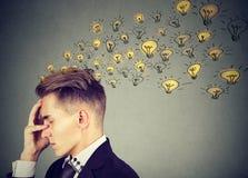 Smart man producing genius ideas Stock Photography