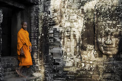 Contemplating Monk in Cambodia. Contemplating monk, Angkor Wat, Siam Reap, Cambodia Royalty Free Stock Photo