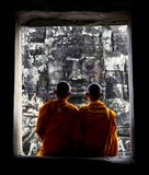 Contemplating monks, Angkor Wat, Siam Reap, Cambodia. Royalty Free Stock Photography