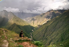 Contemplating the mountains of Machu Picchu, Cusco, Peru Royalty Free Stock Photos