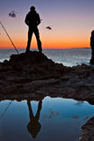 Contemplating the Sunset. Silhouette of man contemplating the Sunset royalty free stock photography