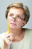 Contemplating woman Stock Image
