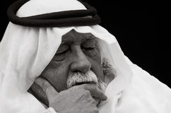 Contemplation. An older gentleman wearing Arabic headdress (a keffiyeh and agal), in contemplation stock image