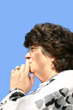 Contemplation. A senior lady thinking deeply against a blue sky Royalty Free Stock Photo