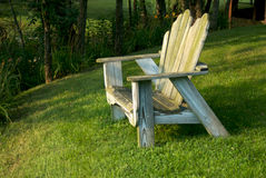 Contemplation. Old lawn chair stock photography
