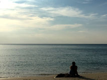 Contemplation. Beach Front Serenity Staring out to the clear blue ocean Royalty Free Stock Photos