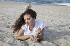 Contemplation at the beach. Woman contemplating at the beach Royalty Free Stock Images