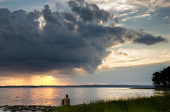 Contemplation. Of a beautiful view of Ottawa river at sundown stock images