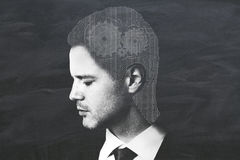 Contemplation concept. Businessman with abstract digital grid head and cogwheels on chalkboard background. Contemplation concept. Double exposure royalty free stock photo