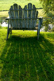 Contemplation II. Old lawn chair royalty free stock photography