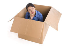Contemplation inside box. A young woman in contemplation, looking outside the box stock photos