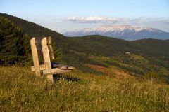 Contemplation. Mountains ,clous , sky and chair for contemplation stock photography