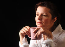 Contemplation over coffee Stock Images
