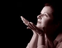 Contemplation in sepia. Woman in serene contemplation, in sepia tones royalty free stock photos