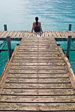 Contemplative. Woman contemplating in wooden dock stock images