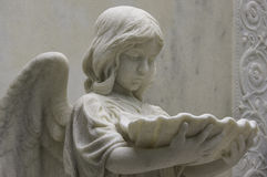 Contemplative Angel with Baptisimal Font Stock Photography