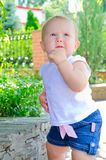 Contemplative baby. Thoughtful kid standing in a park near the curb royalty free stock photos