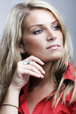 Contemplative beautiful blond woman Stock Image