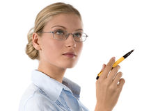 Contemplative business woman with pen Stock Image