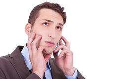 Contemplative businessman talking on phone Stock Photos