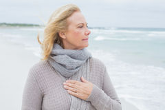 Contemplative casual senior woman at beach Stock Photos