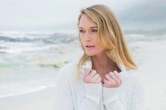 Contemplative casual young woman at beach stock photos