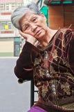 Contemplative elderly woman Stock Photo