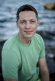 Contemplative Man at Beach Stock Photos