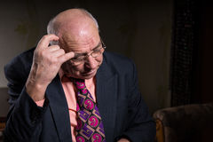 Contemplative Old Businessman Scratching his Head Stock Photos
