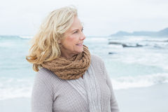 Contemplative senior woman looks away at beach Royalty Free Stock Photos