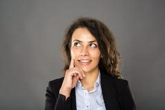 Contemplative smiling businesswoman Stock Photos