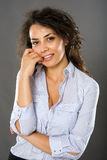 Contemplative smiling businesswoman Stock Image