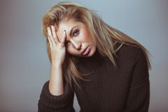 Contemplative woman in sweater Royalty Free Stock Photos