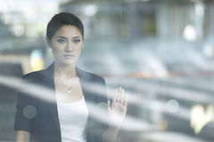 Contemplative Young Business Woman Royalty Free Stock Images