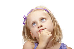 Contemplative young girl  looks up. Stock Photo