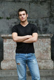 Contemporary. Male model in blue jeans posing Stock Photography