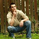 Contemporary. Male model in blue jeans posing Stock Photo