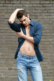 Contemporary. Male model in blue jeans posing Royalty Free Stock Photos