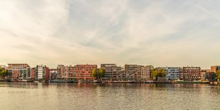 Contemporary apartment buildings and houseboats in Amsterdam Stock Photo