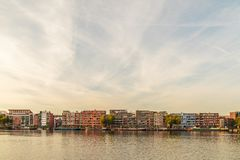 Contemporary apartment buildings and houseboats in Amsterdam Stock Photos