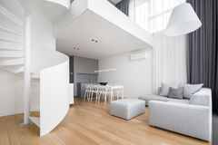 Contemporary apartment with spiral staircase stock photo