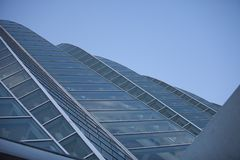 Contemporary architecture. Fragment of a large-span metal construction with panoramic glazing. Modern style building royalty free stock photography