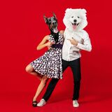 Contemporary art collage. Inspiration, idea, trendy urban magazine style. Young man and woman headed with dog& x27;s heads. Retro dances. Young men and women