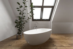 Contemporary attic bathroom with simple tub Stock Photography