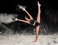 Contemporary ballet dancer dancing on the stage with flour Royalty Free Stock Photography