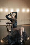 Contemporary ballet dancer on a wooden chair on a repetition Royalty Free Stock Image