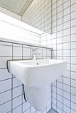 Contemporary bathroom detail with retro tiled wall stock image