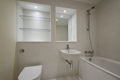 Contemporary bathroom with mozaic tiles. Modern contemporary bathroom with beige mozaic tiles Royalty Free Stock Image