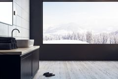 Contemporary bathroom with panoramic view. Contemporary bathroom interior with panoramic winter landscape view. Copy space and design concept. 3D Rendering Royalty Free Stock Image