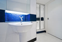 Contemporary bathroom sink. In blue Royalty Free Stock Photography
